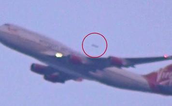 UFO Flying behind Virgin Plane near JFK Airport