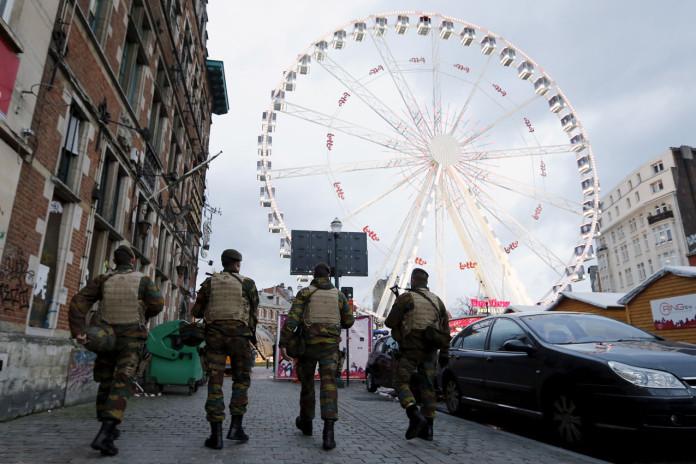Belgian soldiers patrol along