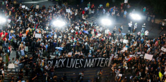 Protests Over Police Shootings Block Roads In U.S. Cities, Arrests Made