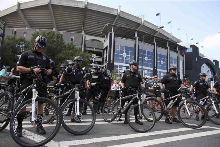 Police stand with their bicycles as a part of a large security presence, outside the football stadium as the NFL's Carolina Panthers host the Minnesota Vikings amid protesting of the police shooting of Keith Scott, in Charlotte, North Carolina, U.S., September 25, 2016. REUTERS/Mike Blake