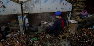 China trash town's cleanup bolstered by import ban