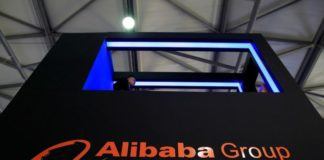 Alibaba beats forecasts again, takes stake in affiliate Ant