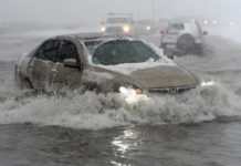 Flood Barriers And Canceled Flights As Storm Pounds U.S. Northeast