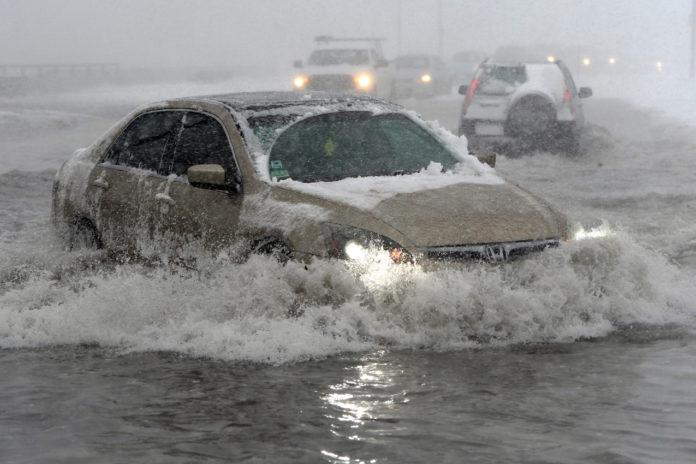 Flood Barriers And Canceled Flights As Storm Pounds U.S. Northeast