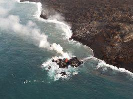 Hawaii volcano eruption forms new lava 'island' just off coast