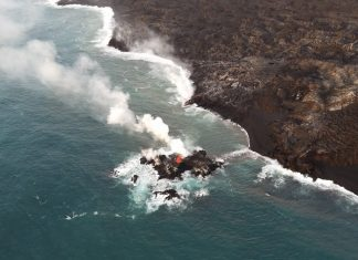 Hawaii volcano eruption forms new lava 'island' just off coast